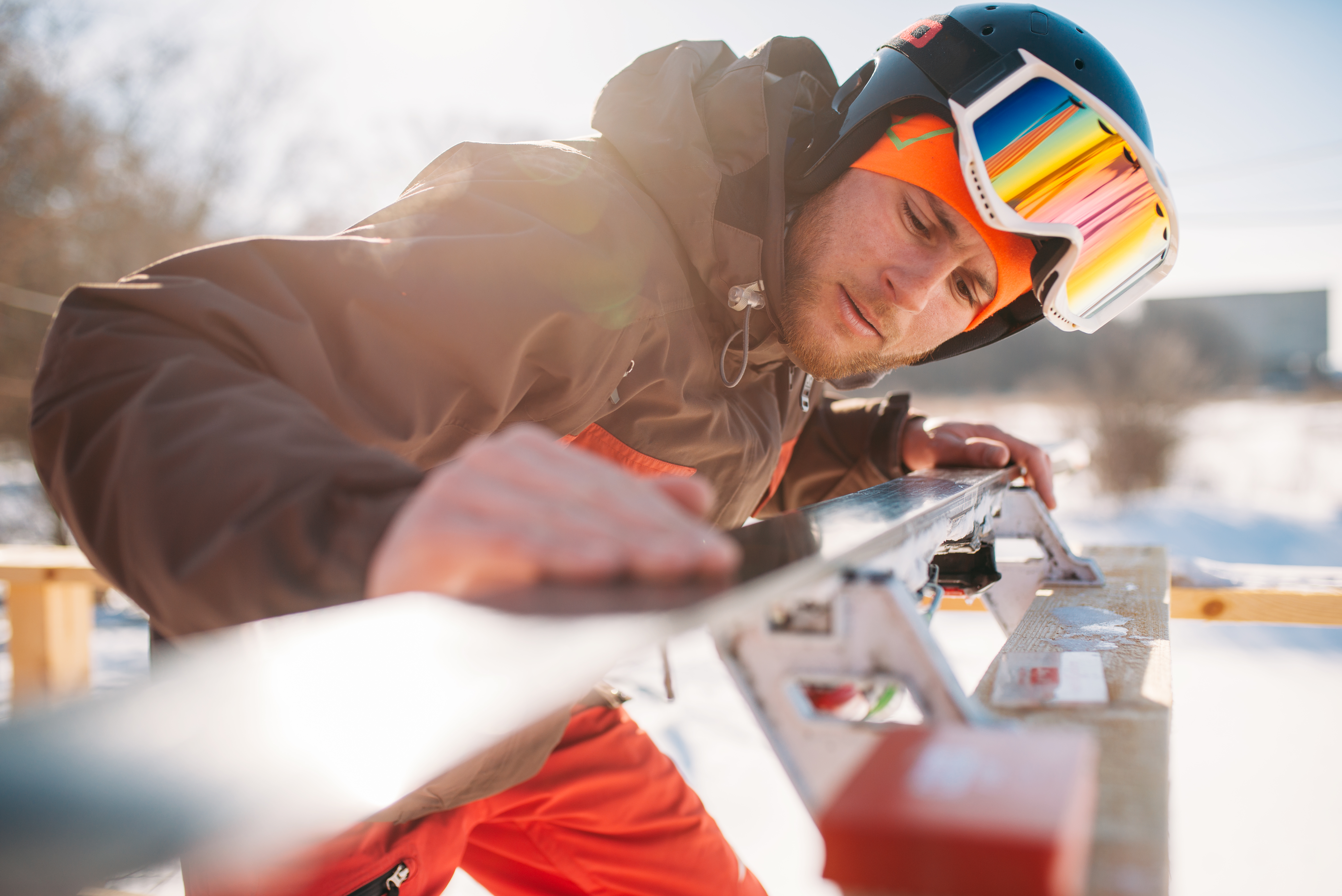 male skier checks skis before skiing winter sport